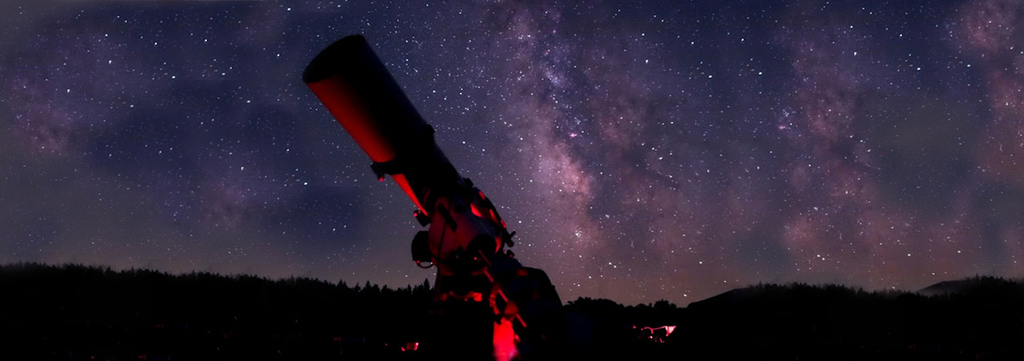 telescope with a stary night backdrop